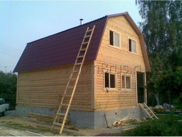 Двухэтажный мансардный дом из бруса 6x8 с террасой